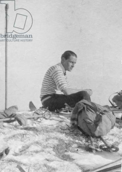 Paul-Emile Victor, during a ski hike, takes a break at the Croix des 7 Brothers, La Poya, Morillon, Haute-Savoie, France, December 1932 (b/w photo)