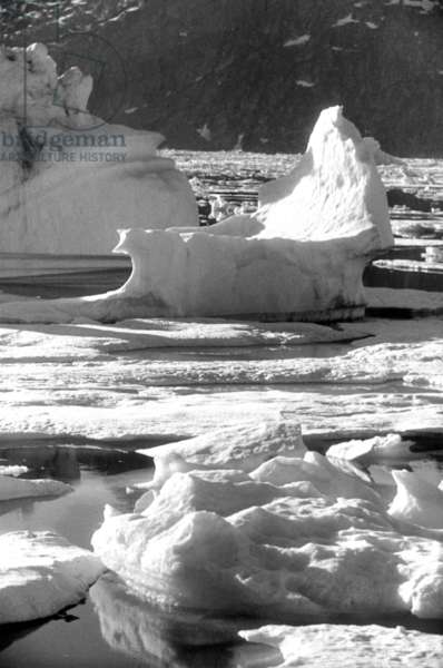 Breaking up of the ice floe in fjord of Kangerdlugssuatsiak, Greenland, Autumn, 1936 (b/w photo)
