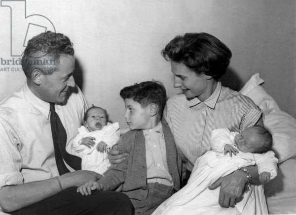 Paul-Emile Victor and the newborn twins, Stéphane (at g) and Daphné, with his first son, Jean-Christophe, and his wife, Éliane, Paris, France, November 1952 (b/w photo)
