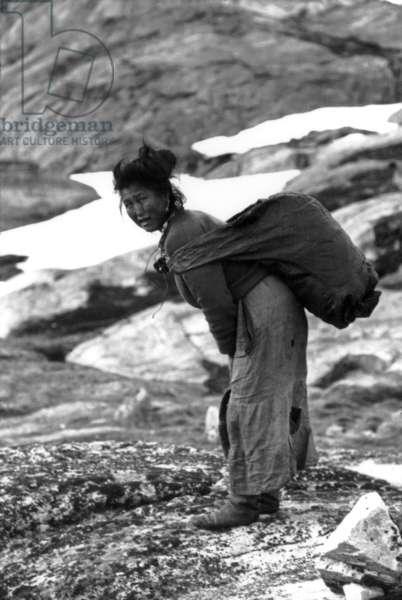Kara, adoptive mother of Paul-Emile Victor, during polar expedition in Greenland, Kangerdlugssuatsiak, Autumn, 1936 (b/w photo)