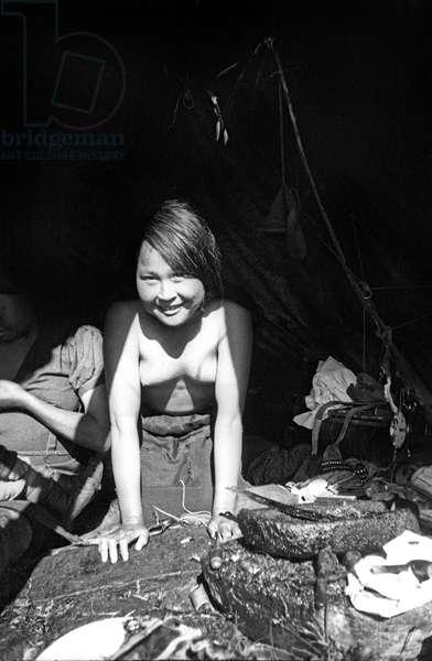 Young Inuit woman, shared hut, fjord of Kangerdlugssuatsiak, Greenland, Autumn, 1936 (b/w photo)