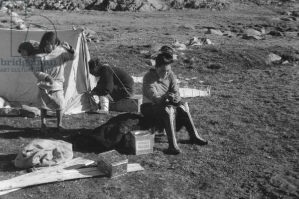 Doumidia, inuit girlfriend of Paul Emile Victor, during polar expedition in Greenland, Kangerdlugssuatsiak, Autumn, 1936 (b/w photo)