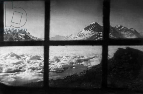 View of Kangerdlugssuatsiak fjord in Greeland from window of house of Paul-Emile Victor, during polar expedition in Greenland, Kangerdlugssuatsiak, Autumn, 1936 (b/w photo)