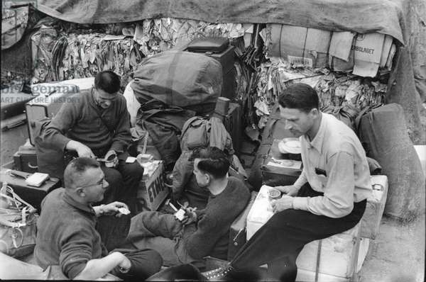 On 12 May 1948, two days before the departure of the first French polar expedition to Greenland, members of the French Polar Expeditions began loading the boat, the Force. Rouen, France, May 1948 (b/w photo)