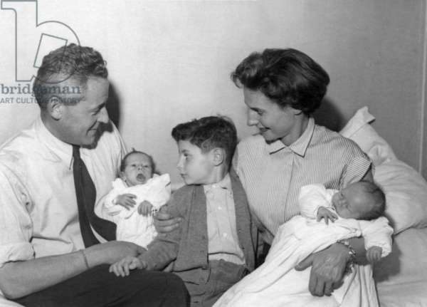 Paul-Emile Victor with his 1st wife Eliane and thier children Jean-Christophe (c) and twins Stephane (l) and Daphne (r) in Paris, November, 1952 (b/w photo)