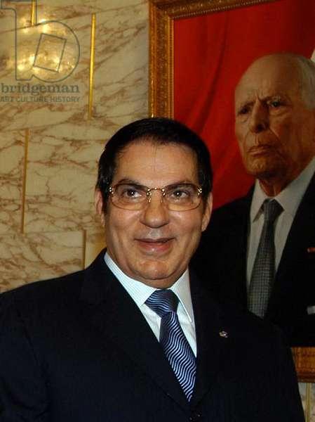 Tunisia: Zine El Abidine Ben Ali, President of Tunisia 1987-2011, in front of a portrait of former President Habib Bourguiba, c.2002.