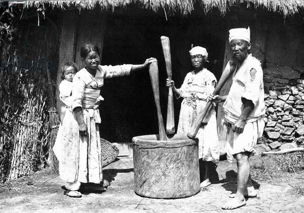 Korea: A peasant family pounding rice, 1904
