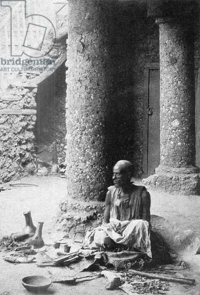 France/Ethiopia: An artisan seated in native clothes, Harar. Photographed by Arthur Rimbaud (1854 - 1891), c. 1883