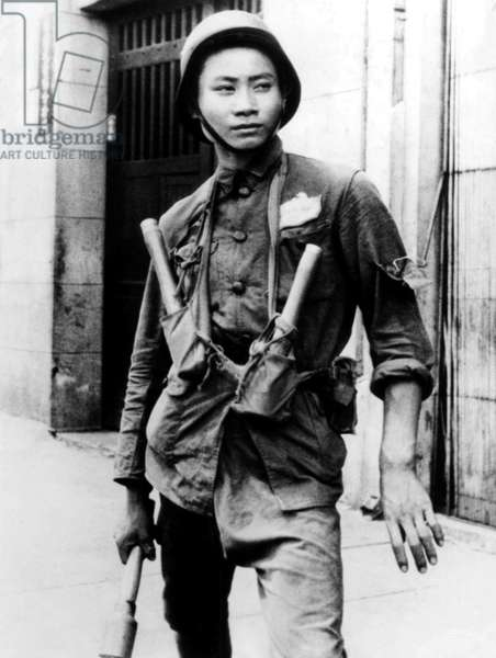 China: Chinese Nationalist soldier armed with stick grenades, Battle of Shanghai, Shanghai, 1937