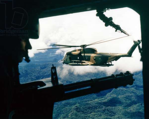 Vietnam: A U.S. Air Force Sikorsky HH-53 Super Jolly Green Giant helicopter seen from the gunner's position in a helicopter of the 21st Special Operations Squadron, Vietnam, October 1972