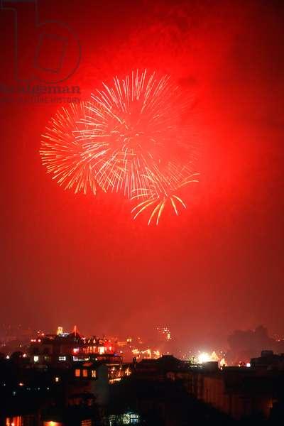 Vietnam: Tet fireworks over Ho Hoan Kiem Lake, Hanoi