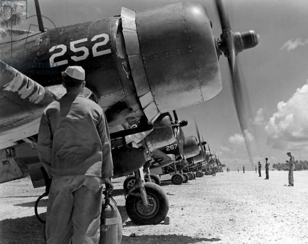 USA / Solomon Islands: U.S. Marines of the 4th Marine Aircraft Wing prepare for sorties in their Vought F4U Corsairs on Guadalcanal, 19 September 1944
