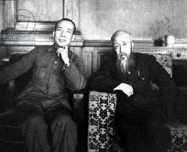 China: Zhou Haiying, the son of celebrated Chinese writer Lu Xun (left), together with Shen Junru, first President of the Supreme People's Court of China in the People's Republic of China