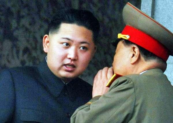 Korea: Kim Jong-un, Supreme Leader of North Korea, talking with DPRK army general