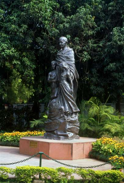 India: Mohandas Karamchand Gandhi (1869-1948) with the Children of India statue, Gandhi Smriti Museum (Birla House), New Delhi