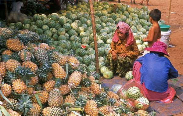 Cambodia: Pineapples and watermelons piled high at a market in Skuon, central Cambodia