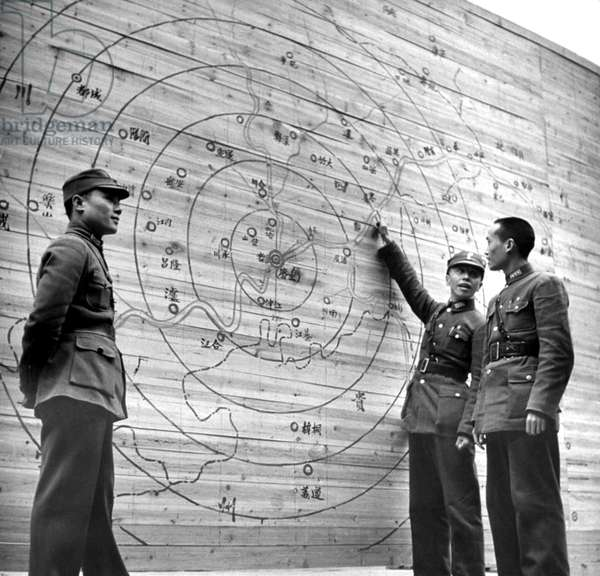 China: Chinese Nationalist Army officers study a map of Chongqing (Chungking) and the surrounding region during the Second Sino-Japanese War, Chongqing, March 1939