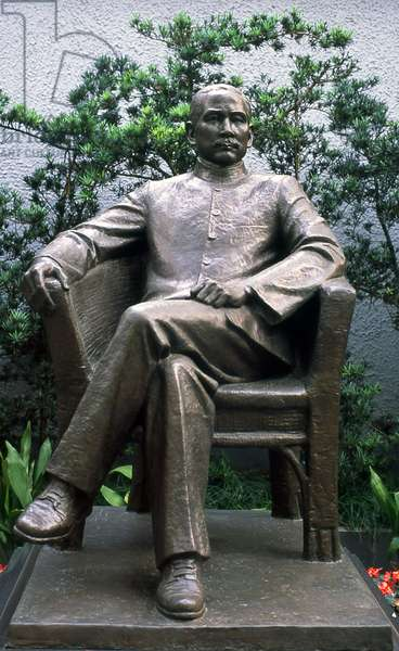 China: Dr Sun Yat-sen (1866-1925), founder of the Chinese Republic, sits outside the Sun Yat-sen Memorial Residence, Shanghai