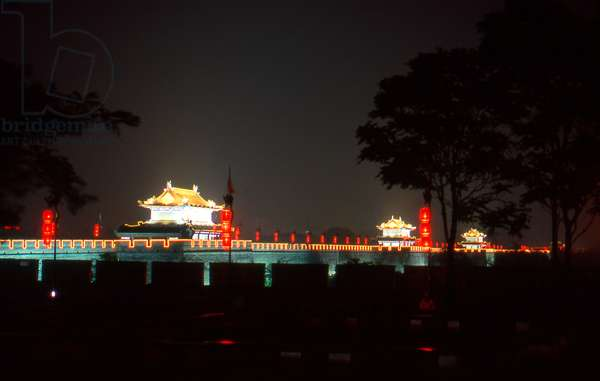 China: Guard towers on Xian's ancient city wall, by night, Xi'an, Shaanxi Province