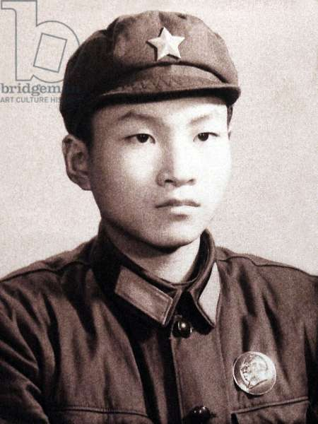 China: Formal portrait of a young 'Red Guard' wearing  a Mao cap with five-pointed red star and a Mao badge on his jacket, c. 1966