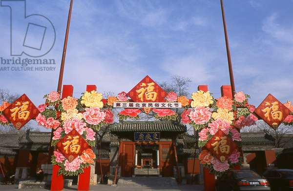 China: Chinese New Year (Spring Festival) decorations at the entrance to the Beijing Dongyue Temple (Temple of the God of Taishan Mountain), a Taoist temple, Beijing