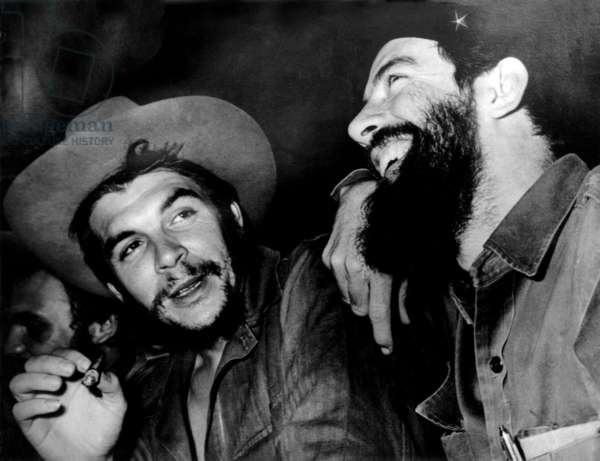 Cuba: Che  Guevara (centre) talks with Camilo Cienfuegos (right), Fidel Castro just visible to left