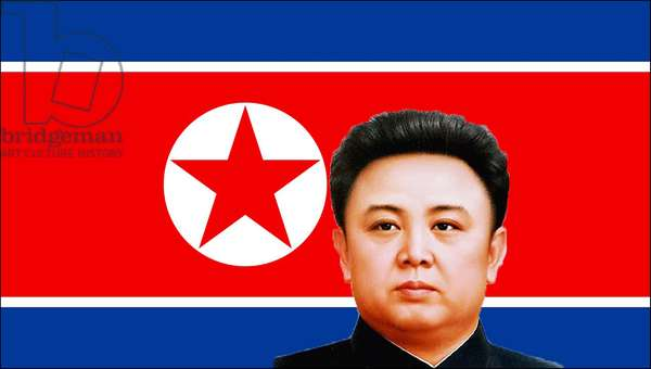 Korea: Pictures of Kim Jong-il, head and shoulders, set against the flag of North Korea (DPRK)