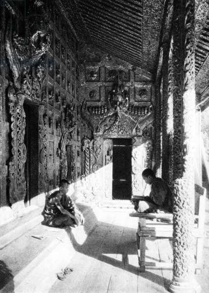 Burma/ Myanmar: A Buddhist monk teaches his student in the Queen's Golden Monastery inside Mandalay Palace, c.1920s.