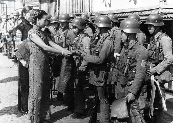 China: Women give thanks to Chinese Nationalist soldiers who held out for days against the besieging Imperial Japanese Army after evacuation of the Chapei, Battle of Shanghai, 1937