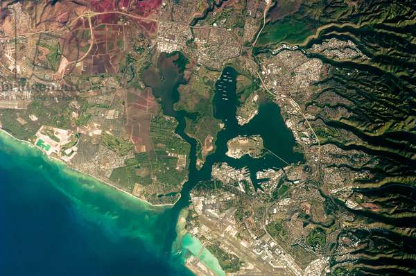 USA: Pearl Harbor, on the southern coastline of the Hawaiian island Oahu, photographed from orbit, NASA, 27 October 2009