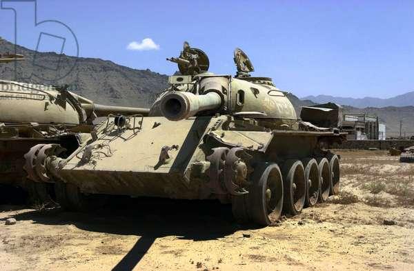 Afghanistan: Two Soviet T-55 Main Battle Tanks sit rusting in a field near Bagram Air Base, Afghanistan, c2002.