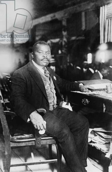 Jamaica: Marcus Garvey (1887-1940), Pan Africanist and Jamaican national hero, seated at his desk, 5 August 1924