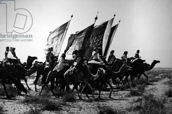 Saudi Arabia: Muslim warriors of Ibn Saud on camel backin Nejd, early 20th century