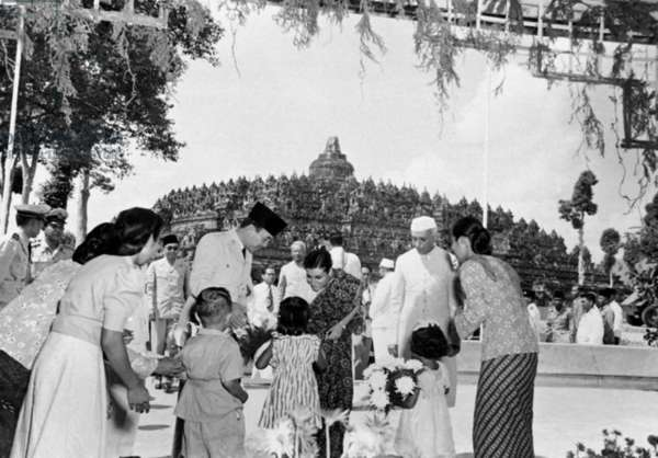 Indonesia: President Sukarno and Indian prime minister Jawaharlal Nehru watching Indira Gandhi receiving flowers during a visit to Borobudur.