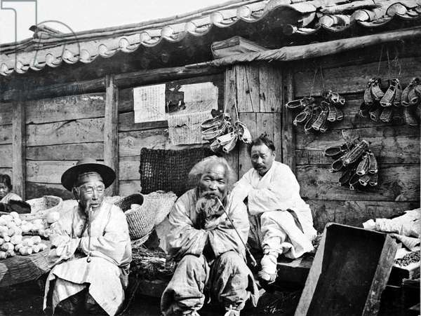 Korea: A group of merchants wrapped against the cold weather, Seoul, c. 1904