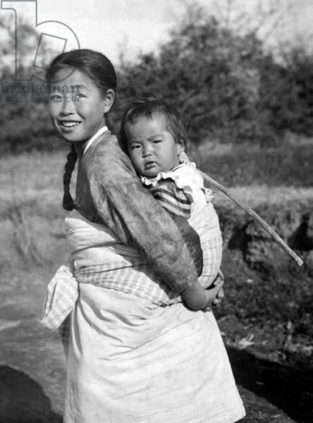 Korea: A girl carrying a child on her back, Heijo (Pyongyang), Korea, 1939