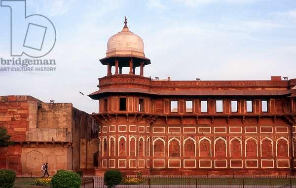 India: Monkeys jumping from the roof of the Jahangiri Mahal (Jahangir Palace) at dusk, Agra Fort, Agra, Uttar Pradesh