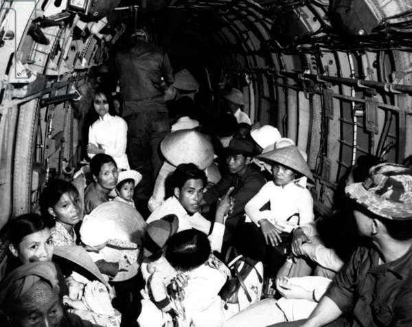 Vietnam: Refugees from the Second Indochina War take a ride on a USAF helicopter to a 'safe area' near Saigon, 1966