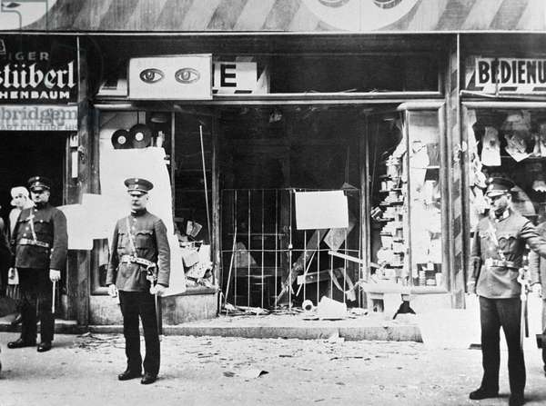 Germany: Police stand outside a Jewish-owned shop vandalised during Kristallnacht, 10 November, 1938 (b/w photo)