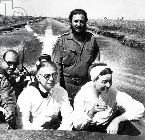 Cuba-France: Jean-Paul Sartre and Simone de Beauvoir on a boat trip with Fidel Castro during their visit to Cuba in 1960 (b/w photo)