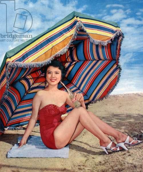 China (Hong Kong): Chinese movie star Diana Chang Chung-wen posing at the beach, 1958