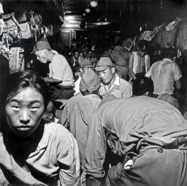 Japan: Demobilized Japanese soldiers and civilians crowd into passenger cars aboard trains bound for Tokyo following the surrender of the Empire of Japan to the Allies, Septemebr 1945 (photo)