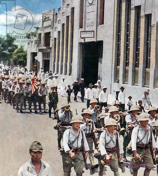 Vietnam: Imperial Japanese troops march through downtown Saigon c. 1944