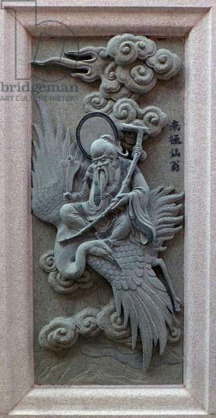 China: Carving of Nan Ji Xian Weng (Immortal of the South Pole), depicting his role in the 16th Century Ming Dynasty novel