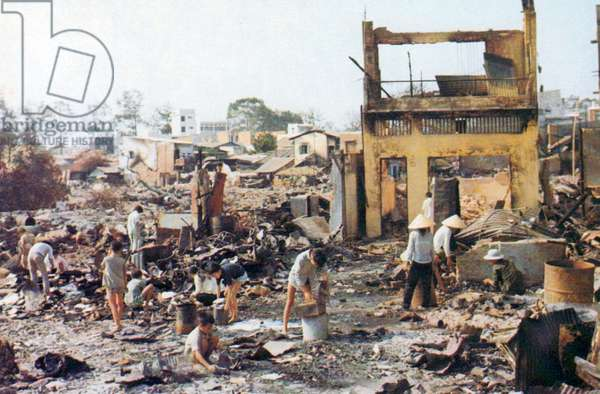 Vietnam: Local people in Cholon picking through the wreckage after the destruction caused by the Tet Offensive of 1968.