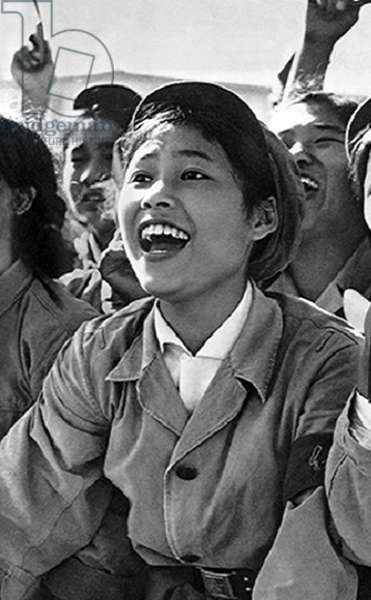China: An enthusiastic young female 'Red Guard' shouts slogans at a cultural revolution rally, Beijing, c. 1966
