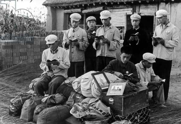 China: Reading Mao Zedong's 'Little Red Book' while waiting for transport, a scene from the Cultural Revolution (1966-1976), 1968