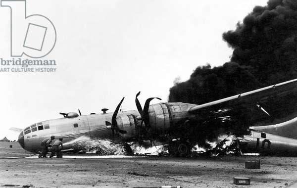 Japan / USA: A Boeing B-29 in flames after an emergency landing at Iwo Jima, Battle of Iwo Jima, March 1945