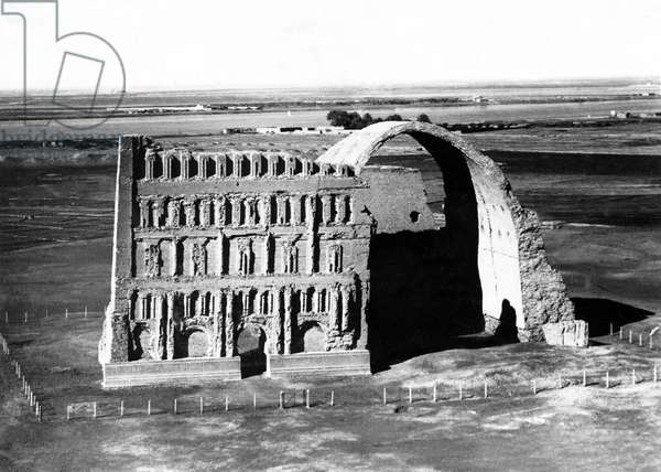 Iraq: Aerial view of Taq Qasra at Ctesiphon, with the great Arch of Ctesiphon after the collapse of the right-hand facade, Roald Dahl, 1940