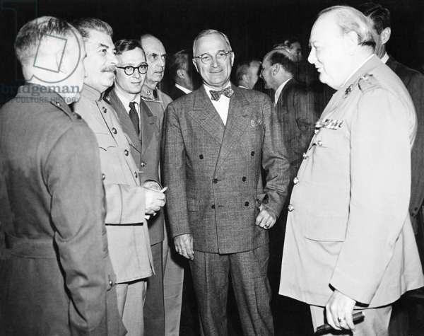 Germany: Joseph Stalin, Harry Truman, Winston Churchill (left to right). The 'Big Three' surrounded by aides at the Potsdam Conference (Potsdamer Konferenz), 28 November - 1 December 1943